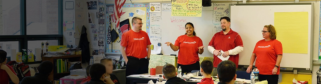 Travelers employees volunteering in classroom