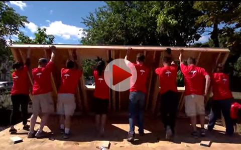 Travelers employees building home