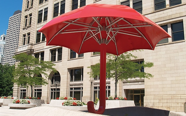 Travelers umbrella in front of main office