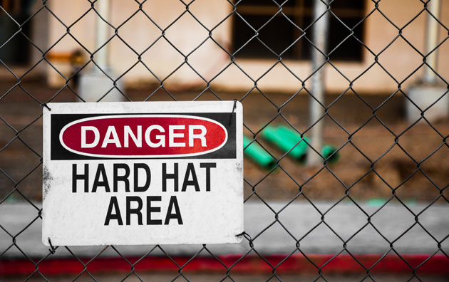 Hard hat area danger sign in front of construction site