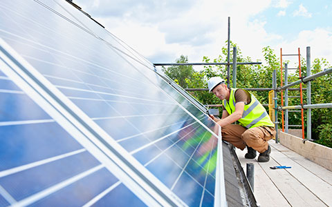 energy professional installing solar installations