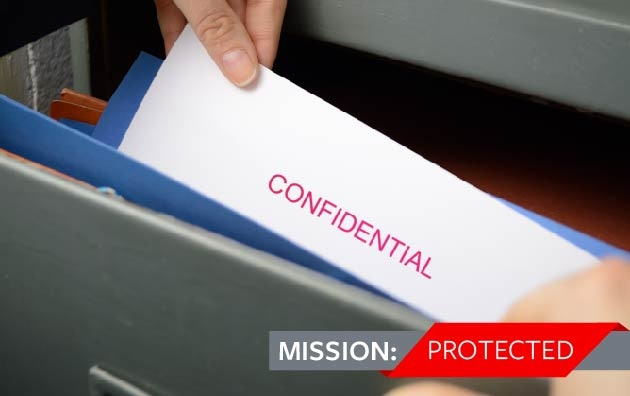 Nonprofit employee pulling confidential document
