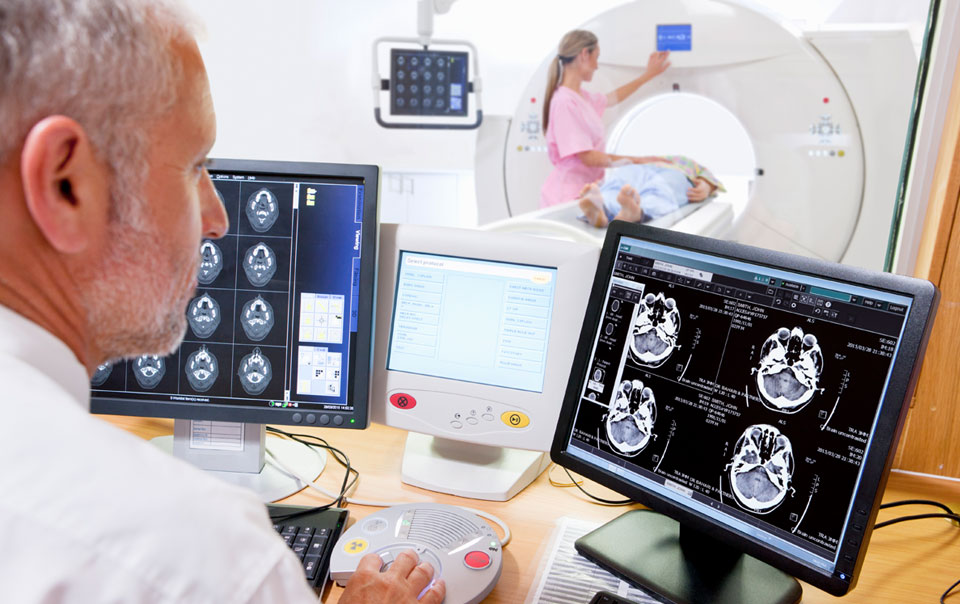 Doctor using medical IoT to see patient X-rays