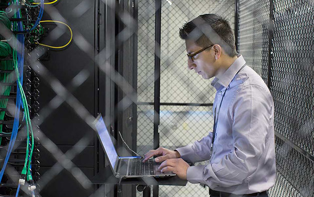 Person using computer in server room to protect against Shadow IT
