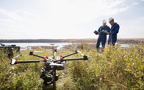 commercial employees using drone to monitor land