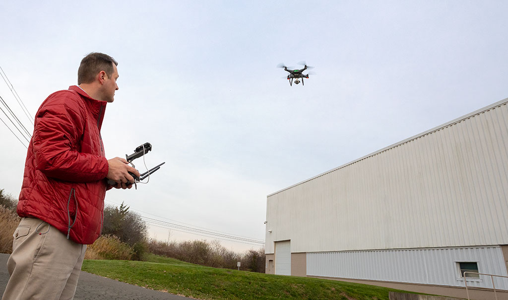 Travelers employee flying drone above building