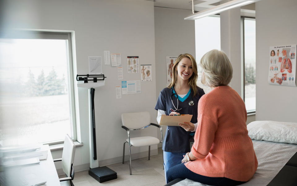 Nurse assisting patient in doctor's office