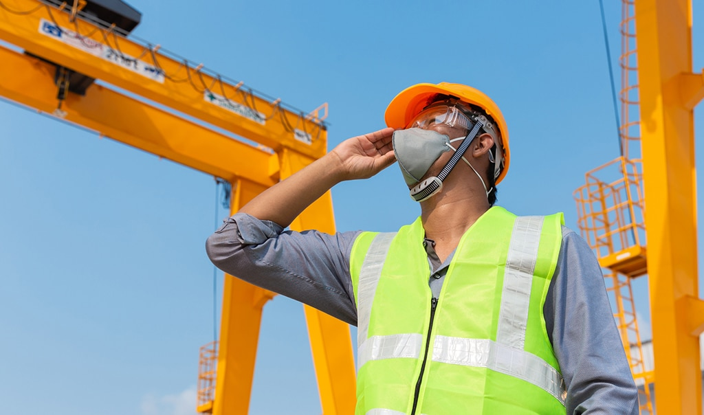 man wearing a mask at a construction site