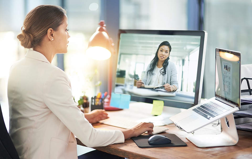 Two women virtually conferencing