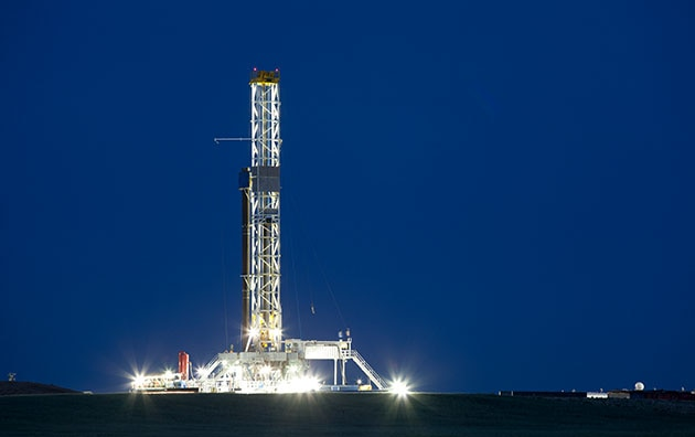 Oil and gas rig at night