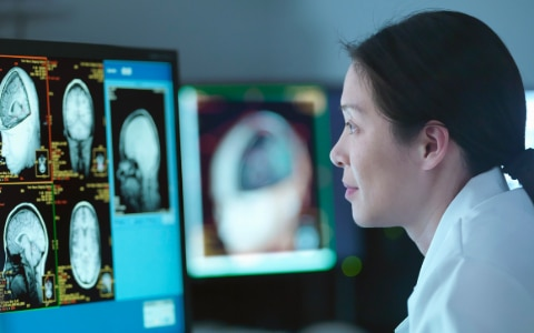 woman looking at brain scans