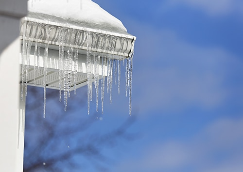 ice dam hanging off roof