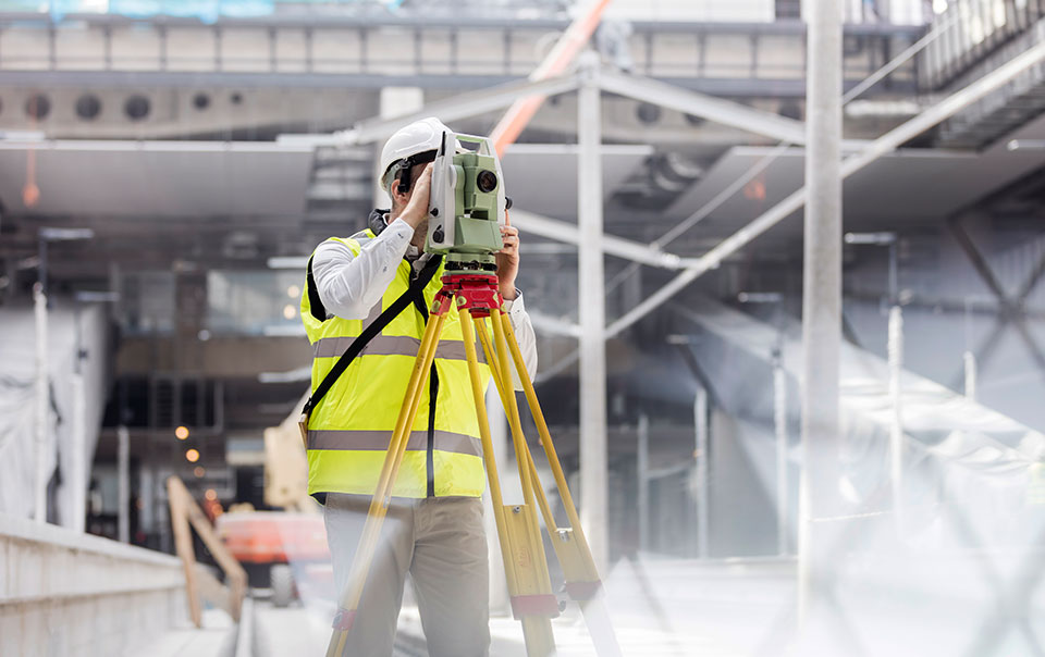 construction worker surveying site for vibration damage risks