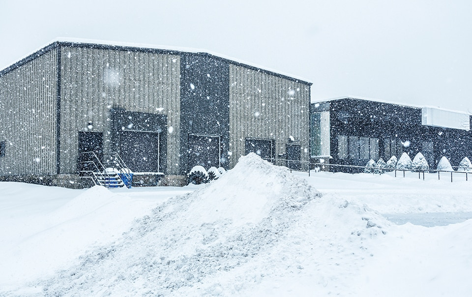 snow falling on commercial building