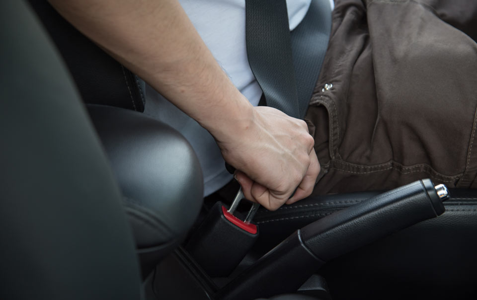 Worker putting on seat belt