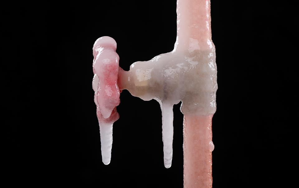 Close-up of frozen pipes