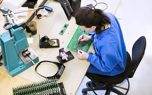 Person looking at counterfeit electronic parts