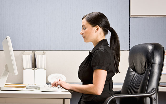 Woman sitting ergonomically correct at her desk