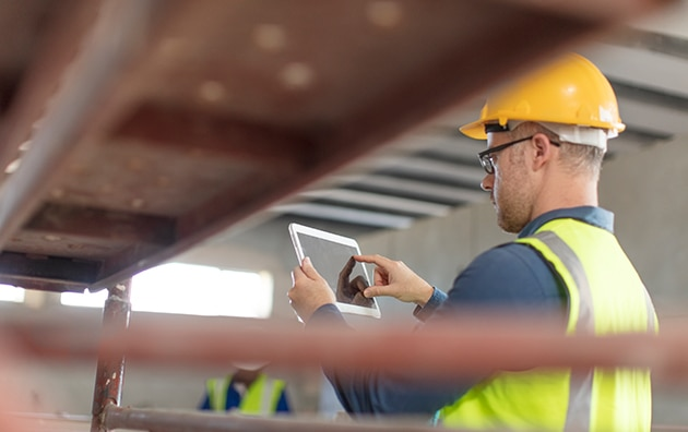 construction worker using a tablet