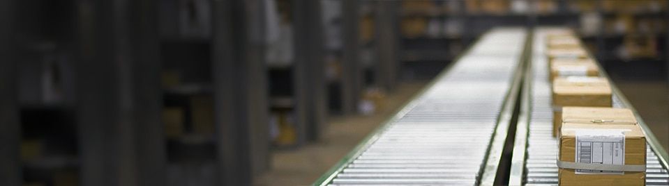 Boxes on a supply chain conveyor belt