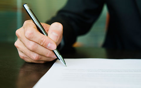 person signing a contractual risk transfer contract
