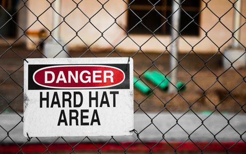 Hard hat area sign in front of construction site