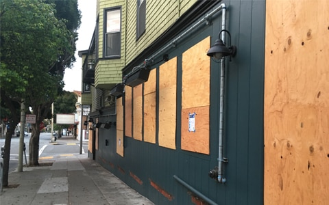 Image of boarded up business. How to Protect Your Business Property During Times of Civil Unrest