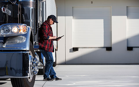 truck driver reviewing truck telematics