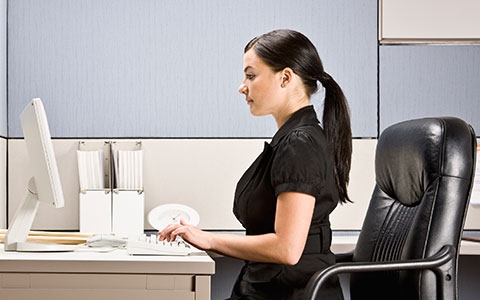 woman sitting ergonomically correct in chair