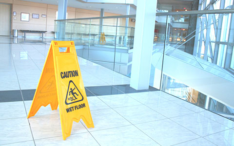 Slippery when wet sign inside a business lobby