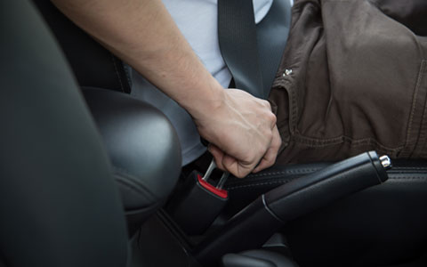 Driver buckling in seat belt