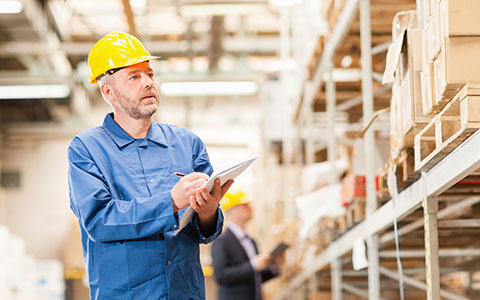 employee conducting inventory as part of supply chain management