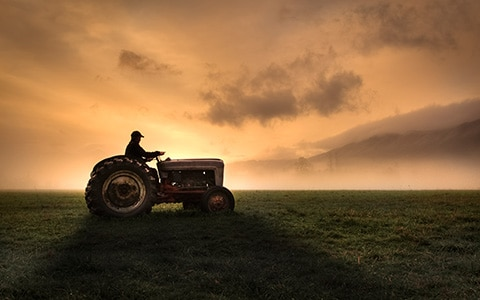Farmer driving on a tractor