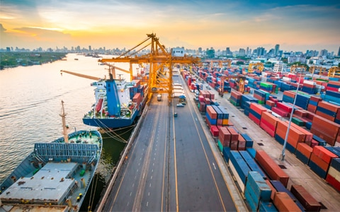 image of a port with ships loading and unloading cargo trailers, 4 Ways Freight Brokers Can Help Prevent Strategic Cargo Theft