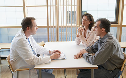 doctor meeting with business worker about injury management