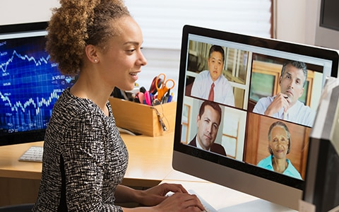 A woman working from home is on a video conference call. Managing Remote Workers During COVID-19