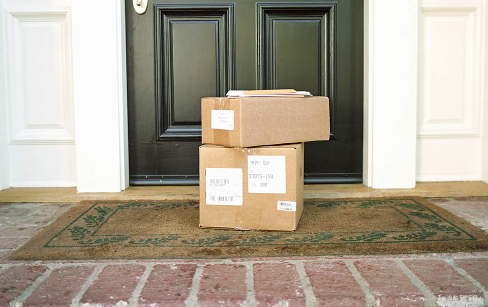 Packages on the front step of a house