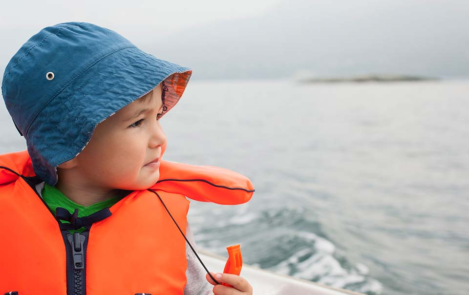 Young boy wearing life vest