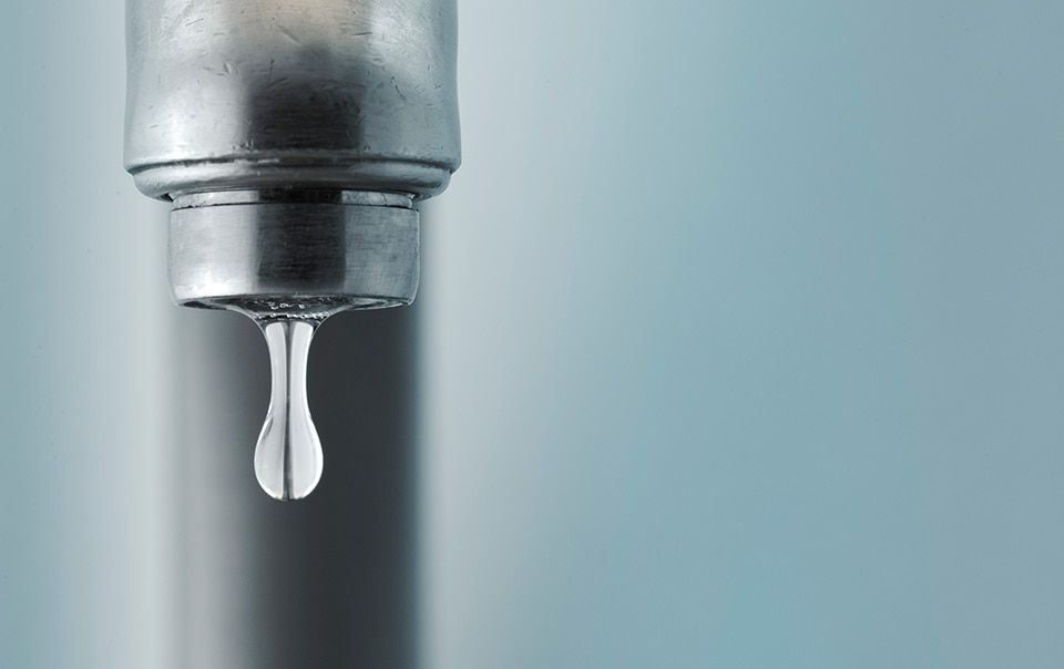 Close-up of a dripping faucet