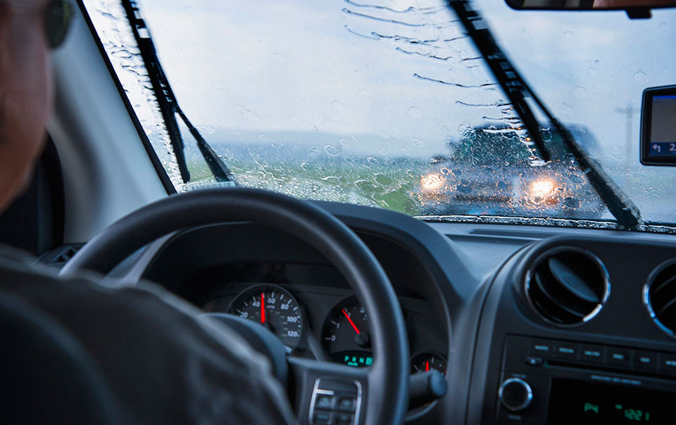 Man driving in a spring storm