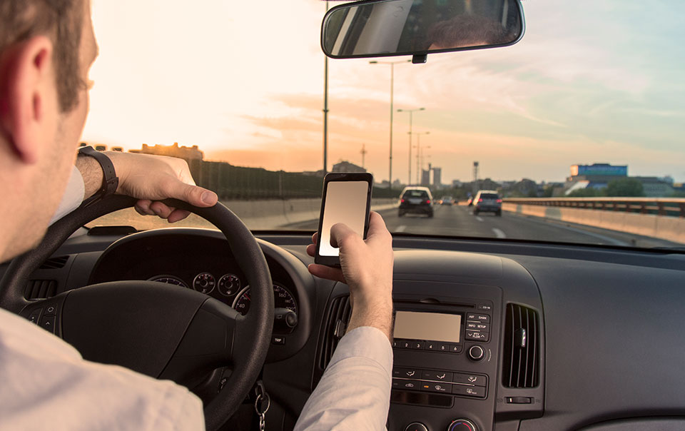 Woman driving distracted behind the wheel