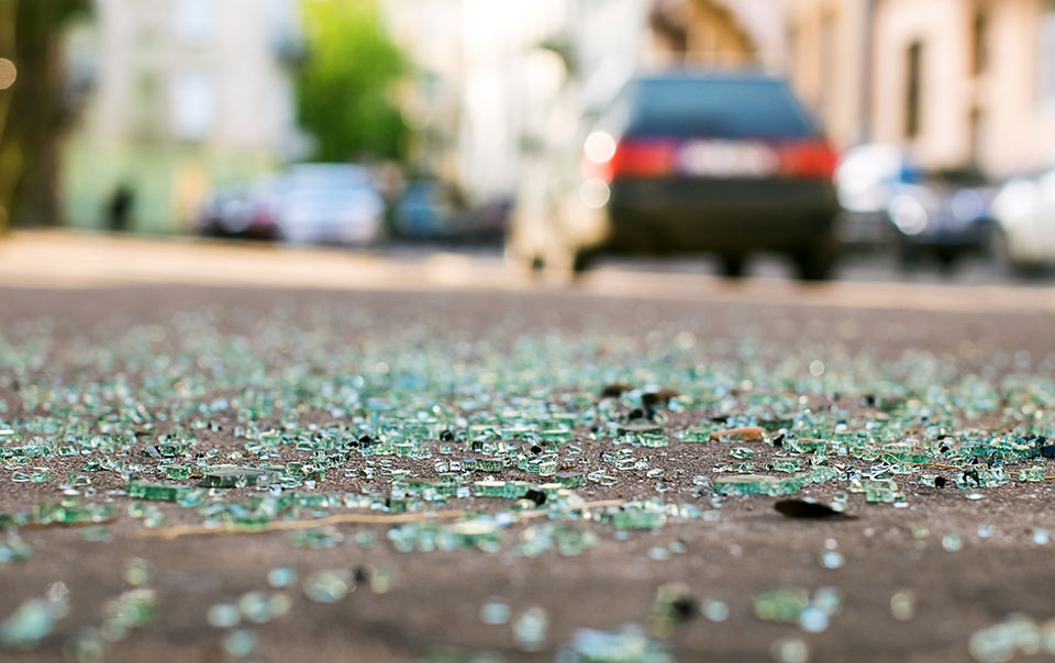 Broken glass on road after a car accident