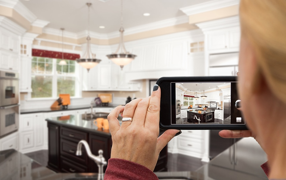 A person videotaping the staging of a home for sale