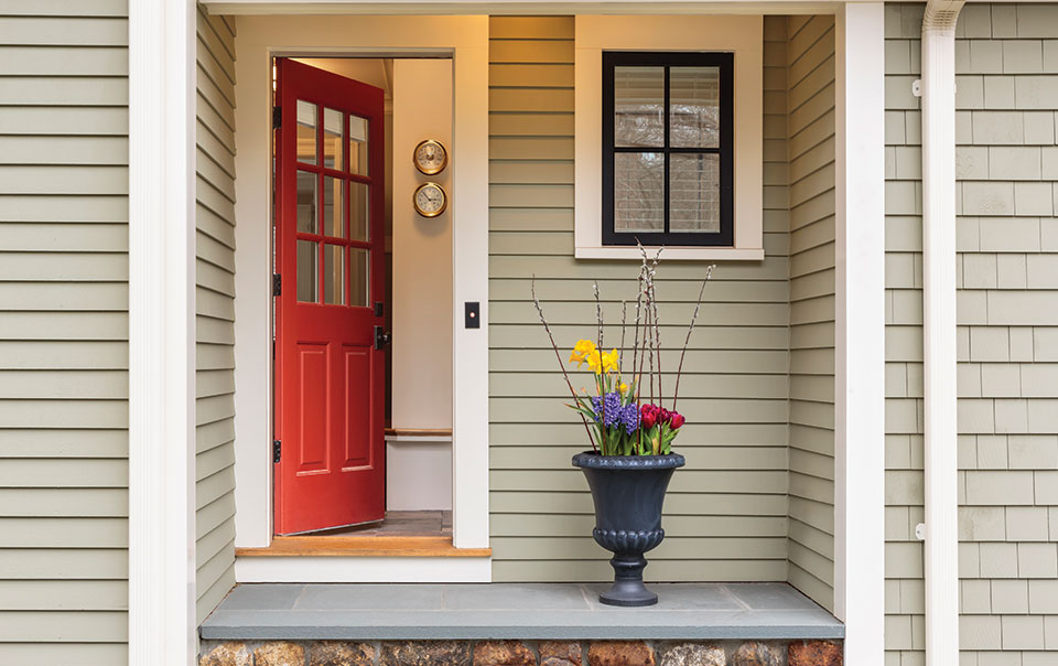 Image of home with the front door ajar. Does Homeowners Insurance Cover Theft?