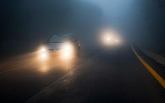Cars driving in fog