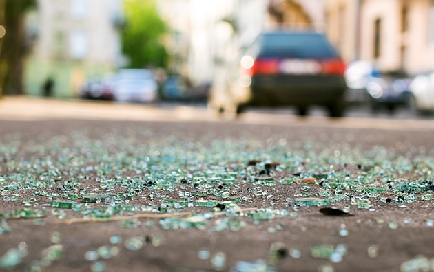 broken glass on a road after a car accident