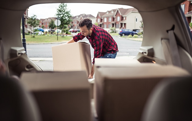 man loading car to move