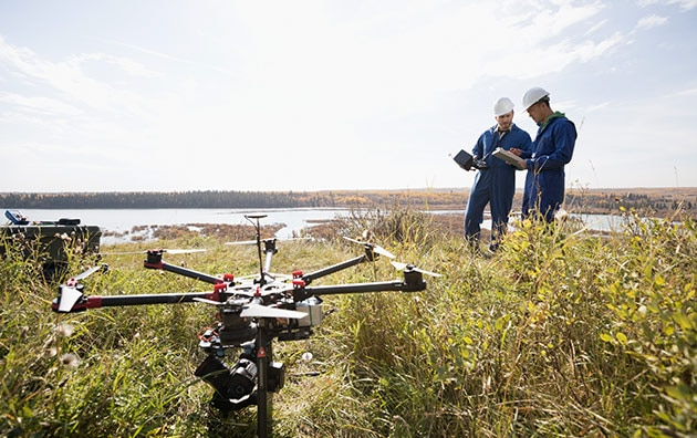 Professionals using drones on the job in a field