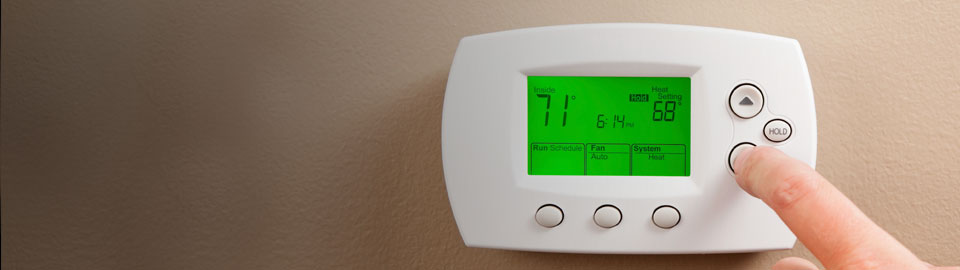 snowbird adjusting thermostat before leaving house