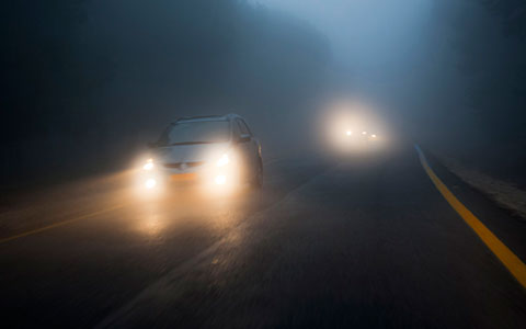 Cars driving in fog at night